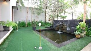 desain kolam ikan di halaman rumah